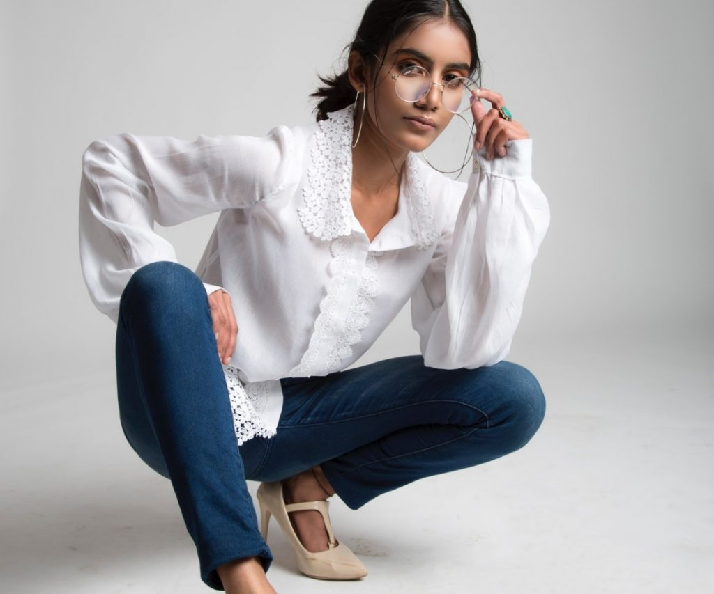 woman-in-white-long-sleeve-shirt-and-blue-denim-jeans